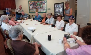Assisted living residents enjoy socializing during Coffee Club.