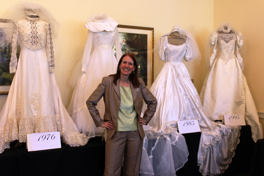 Presenter Leigh Anne Brown poses with several of her vintage wedding gowns.