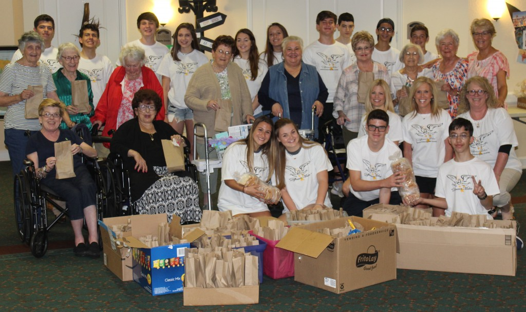 Assisted Living Residents & Teens Pose with 200 meals