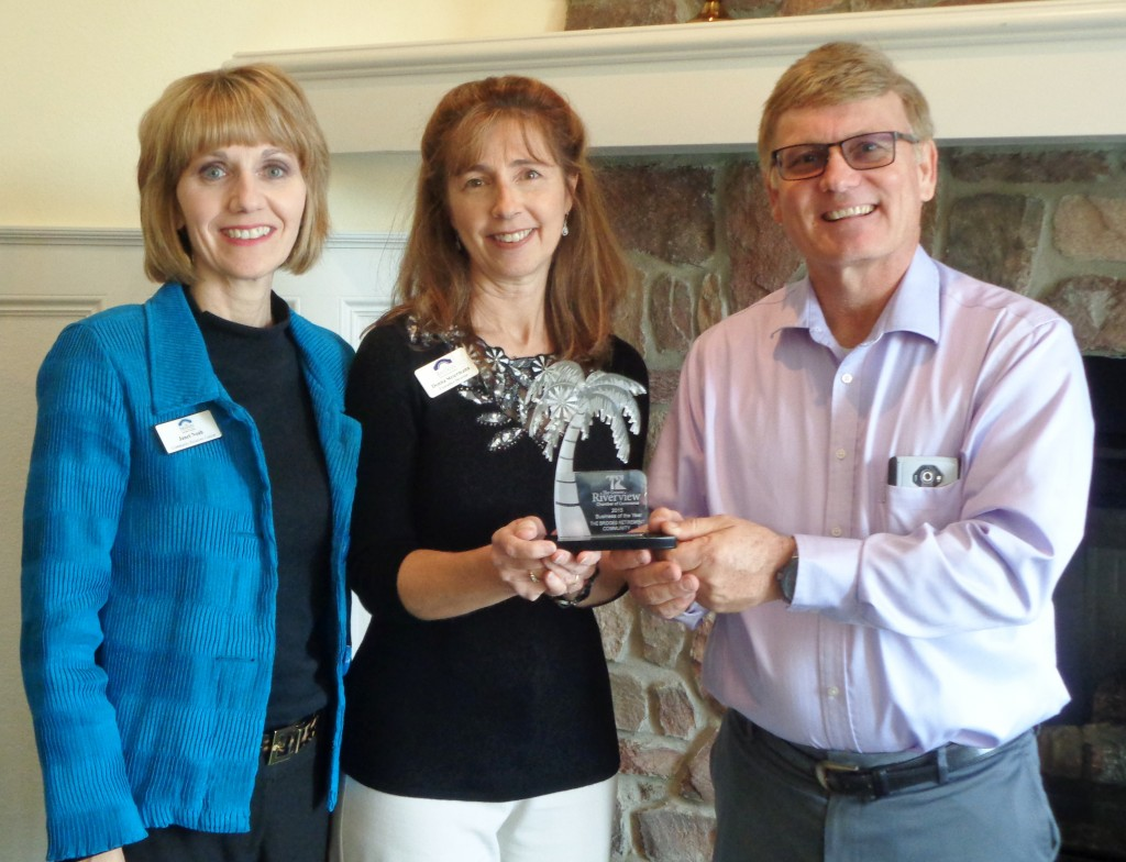 Riverview Chamber of Commerce President Bryan Thatcher presents the award to Donna Steiermann and Janet Noah of The Bridges.