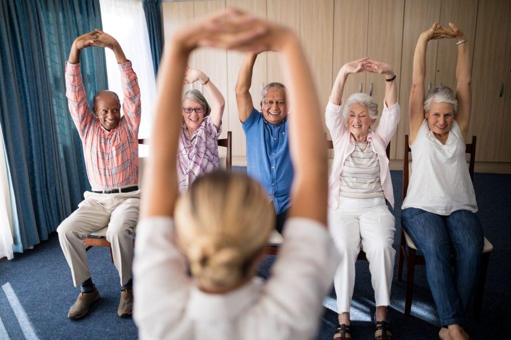 Senior Citizens performing Chair Yoga